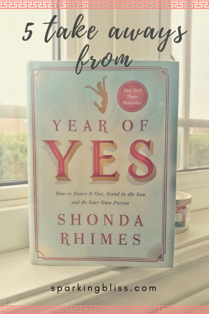 a book on the window still that says 'year of yes by shonda rhimes'