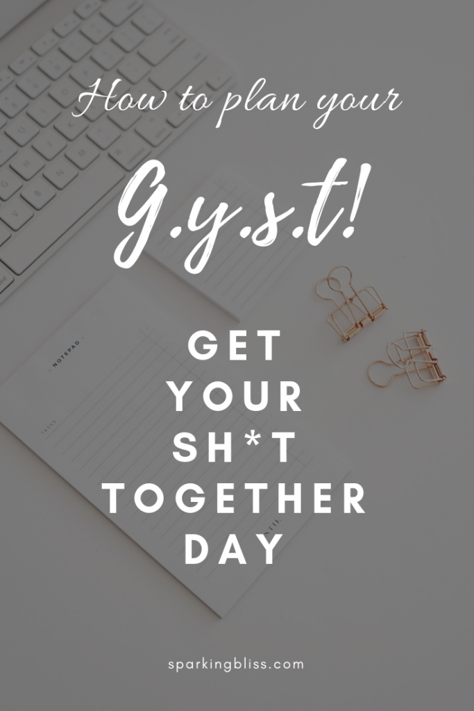 notepad and keyboard with the caption 'gyst - get your shit together day'