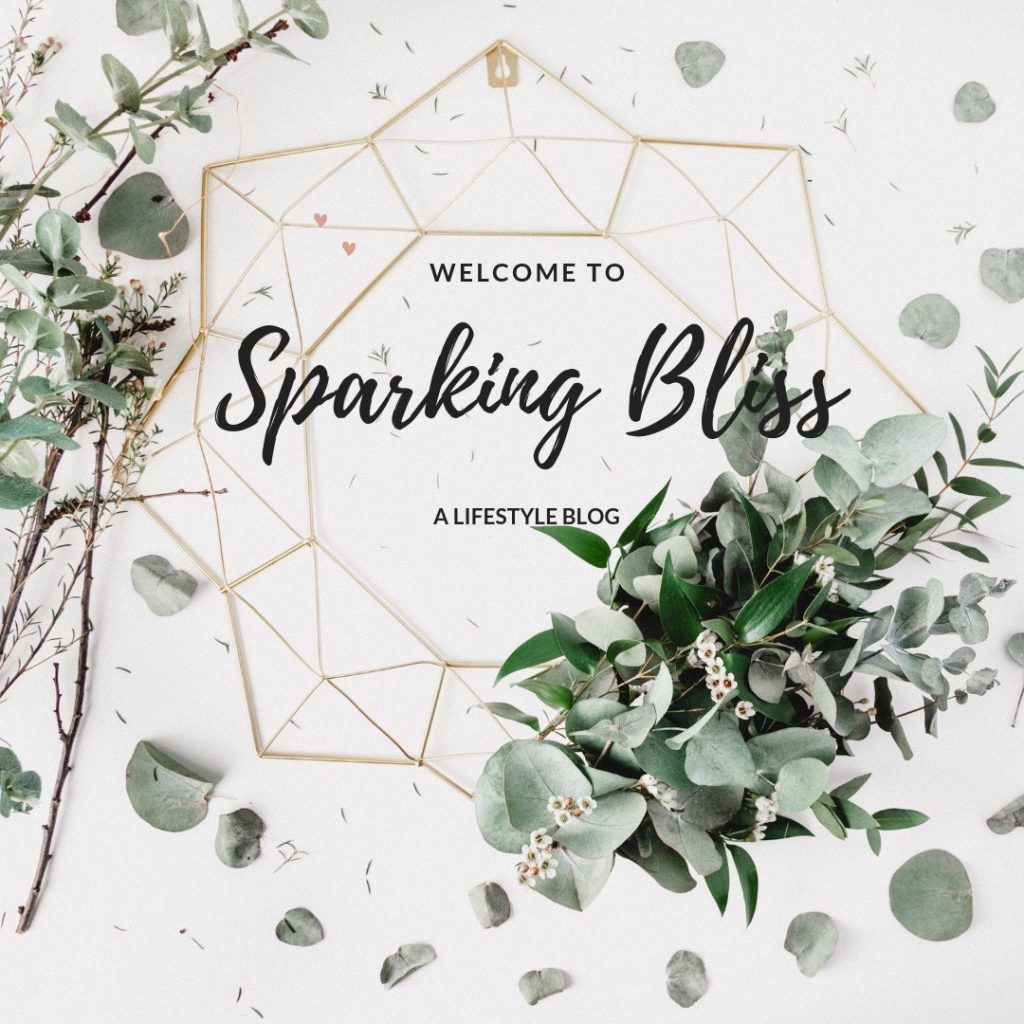sparking bliss logo surrounded by white flowers